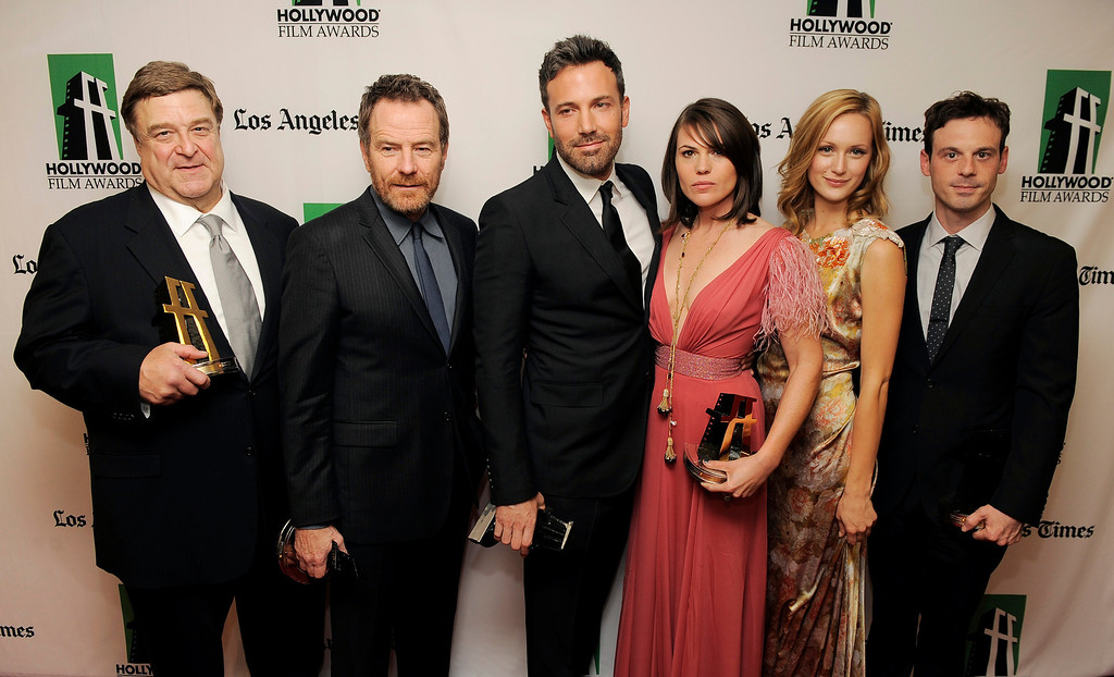 ". ""Argo\"" cast members, from left, John Goodman, Bryan Cranston, Ben Affleck, Clea DuVall, Kerry Bishe\' and Scoot McNairy, recipients of the Hollywood Ensemble Acting Award, pose together backstage at the 16th Annual Hollywood Film Awards Gala on Monday, Oct. 22, 2012, in Beverly Hills, Calif. (Photo by Chris Pizzello/Invision/AP)"