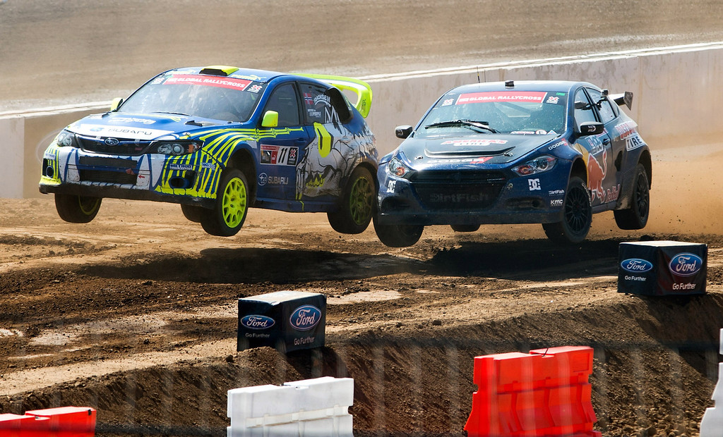 . Drivers Sverre Isachsen (#11), left, and Travis Pastrana (#199) compete in the Ford RallyCross SuperCar final round during X Games Los Angeles at Irwindale Event Center on Sunday, August 4, 2013. Isachsen won bronze.  (SGVN/Staff photo by Watchara Phomicinda)