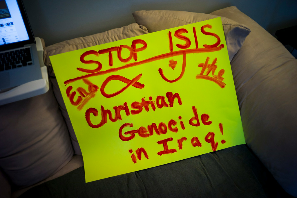 . Activists prepare signs for a rally Saturday in North Hollywood.  A group of local Christians is calling for action for Christians who are being terrorized and killed in the middle east.   ( Photo by David Crane/Los Angeles Daily News )
