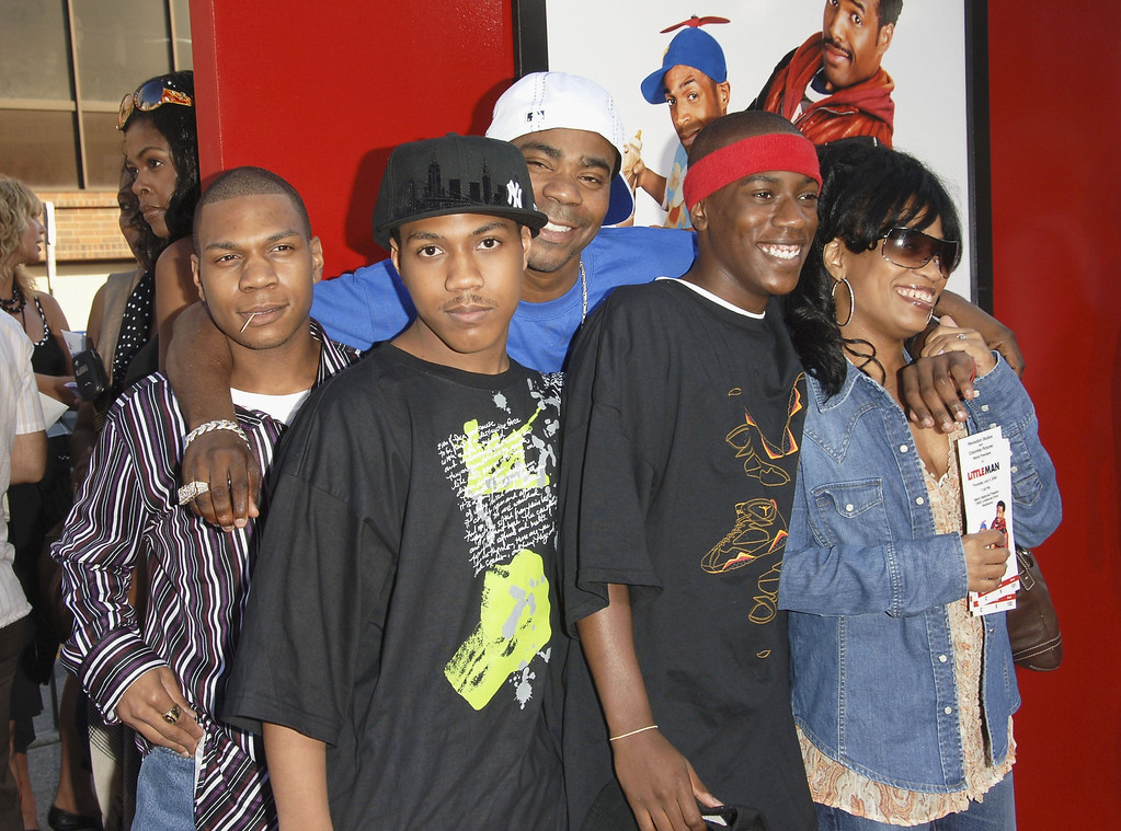 ". Actor Tracy Morgan (in rear wearing white hat) and his family attend Sony Pictures premiere of ""Little Man\"" at the Mann National Theater on July 6, 2006 in Westwood, California.  (Photo by Stephen Shugerman/Getty Images)"