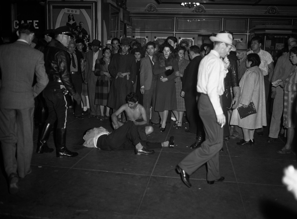 . These youths, one stripped of all his clothes, the others badly beaten, fell victim to ranging bands of policemen who scoured the streets in Los Angeles June 7, 1943, ferreting out and beating zoot-suited young hoodlums they blame for the numerous recent unprovoked assaults.  Fifty or more zoot suiters had their clothing torn from them, police reported. (AP Photo/Harold P. Matosian)