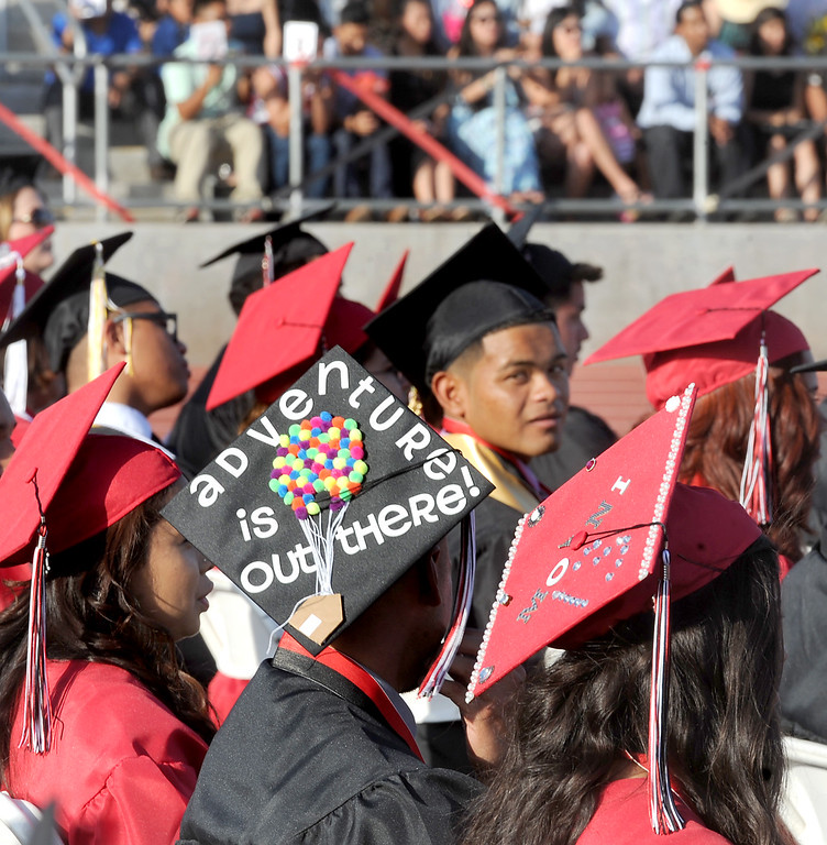 ". Ivan Ramos wearing a cap with the message ""Adventure is Out there!\"", during Sierra Vista High School Graduation in Baldwin Park Thursday, May 30, 2013.   (Walt Mancini/San Gabriel Valley News)"