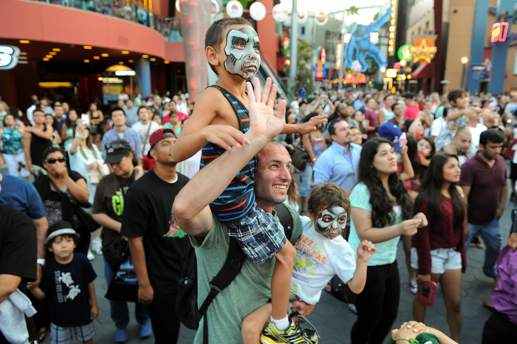 . Barrett Graf, of Palos Verdes, holds his sons Spencer, top, and Maxwell during a DJ performance at 5 Towers at Universal CityWalk. Friday, July 6, 2013. (Michael Owen Baker/L.A. Daily News)
