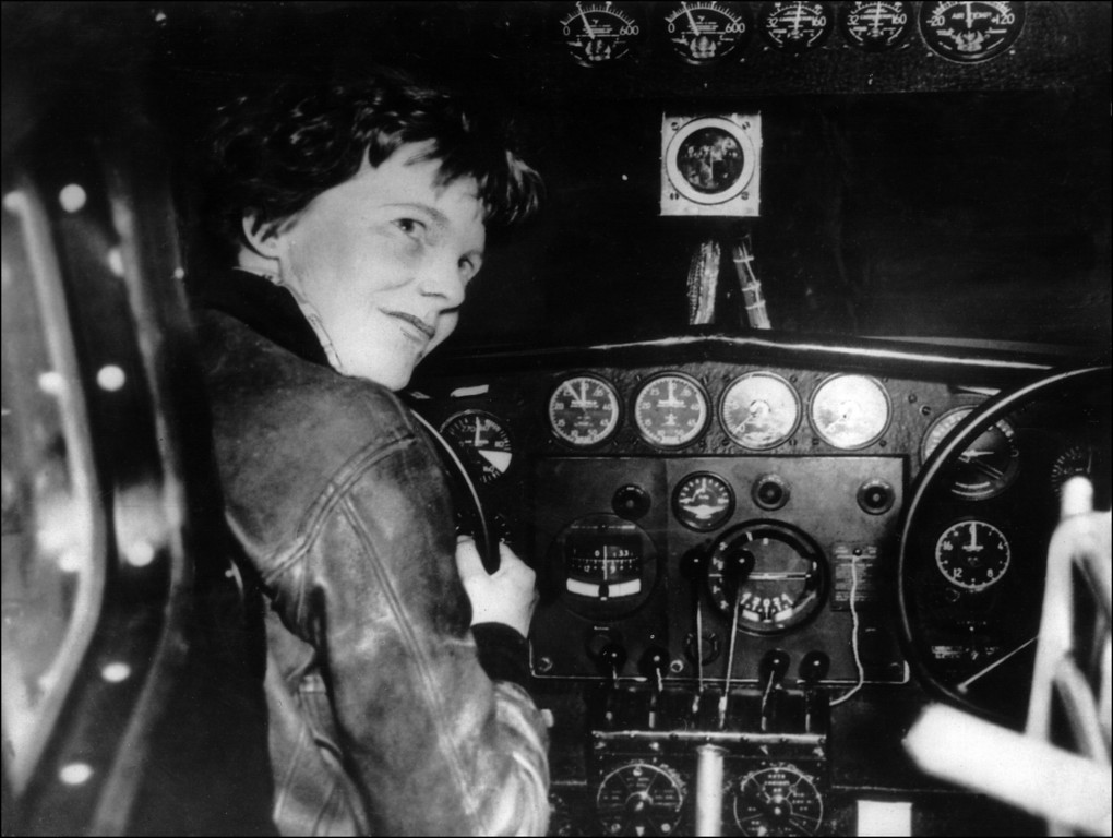 . FRANCE - JANUARY 1:  Undated picture taken in the 30\' s of American female aviator Amelia Earhart beeing at the controls of her plane. Amelia Earhart was the first woman to fly the Atlantic as a passenger, in 1928, and followed this by a solo flight in 1932. In 1935 she flew solo from Hawan to Califofrnia. In 1937, with Fred Noonan, they set out to fly round the world, but their plane was lost over the Pacific, 02 July.  (STAFF/AFP/Getty Images)
