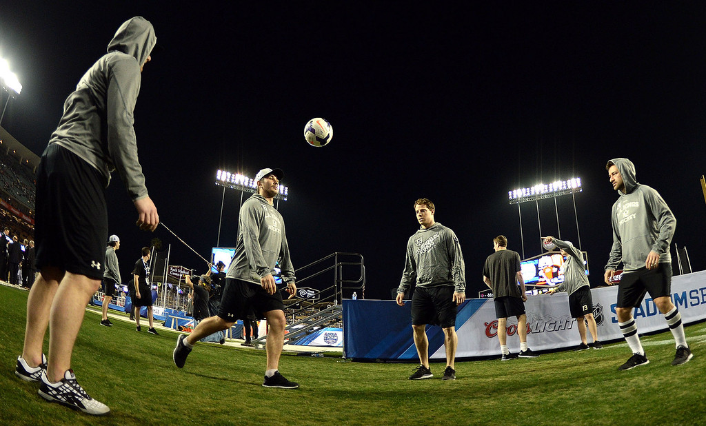 . Los Angeles Kings player kick a soccer ball prior to the start of the inaugural NHL Stadium Series game against the Anaheim Ducks at Dodger Stadium in Los Angeles on Saturday, Jan. 25, 2014. (Keith Birmingham Pasadena Star-News)