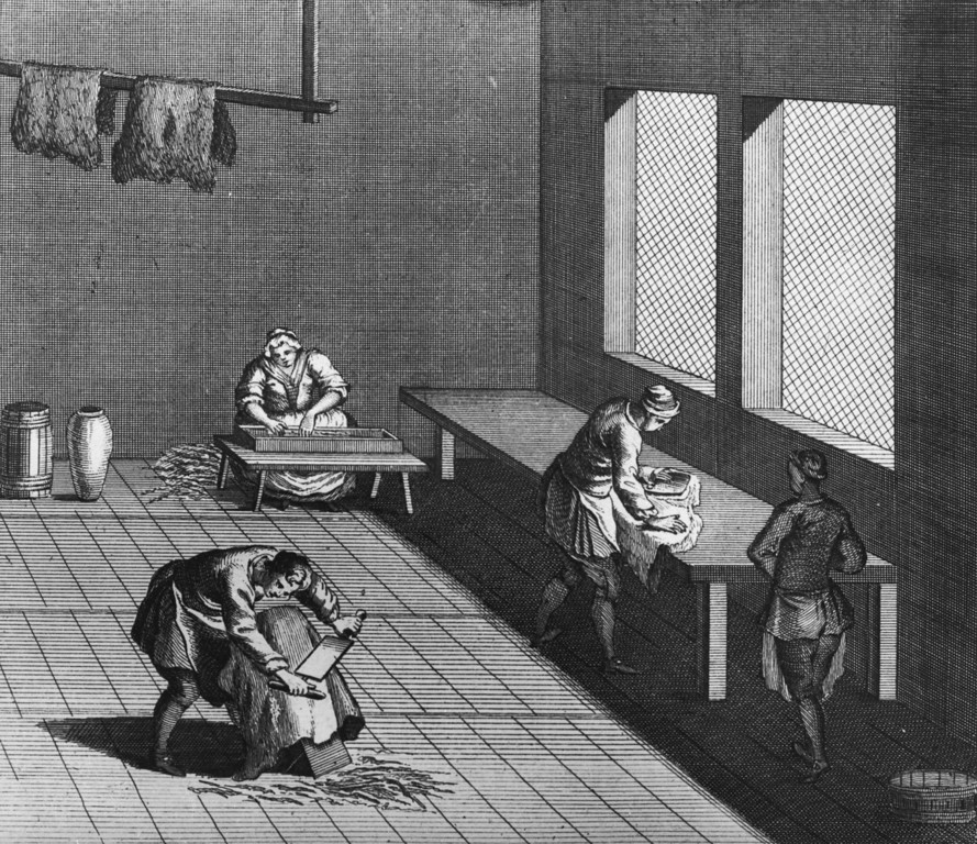 . Curriers prepare tanned leather hides in a workshop, circa 1750. (Photo by Hulton Archive/Getty Images)