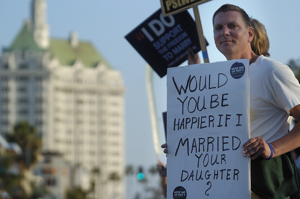 . LONG BEACH, CALIF. -- Greg Marconi carries a sign at the corner of Broadway and Alamitos Ave. in Long Beach, Calif. on May 27, 2009. The protesters are upset that the California Supreme Court upheld Proposition 8 banning gay marriage.     Photo by Jeff Gritchen/Long Beach Press-Telegram