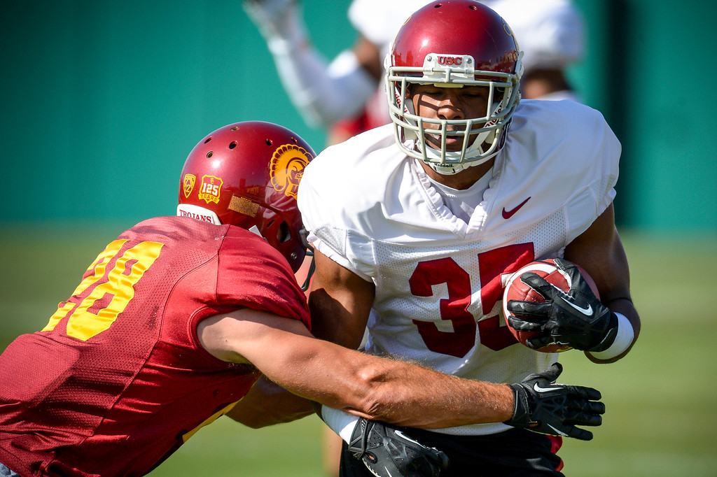 . USC�s Christian Tober wraps up Adrian Johnson during spring practice at USC Tuesday, April 15, 2014.  (Photo by David Crane/Los Angeles Daily News.)