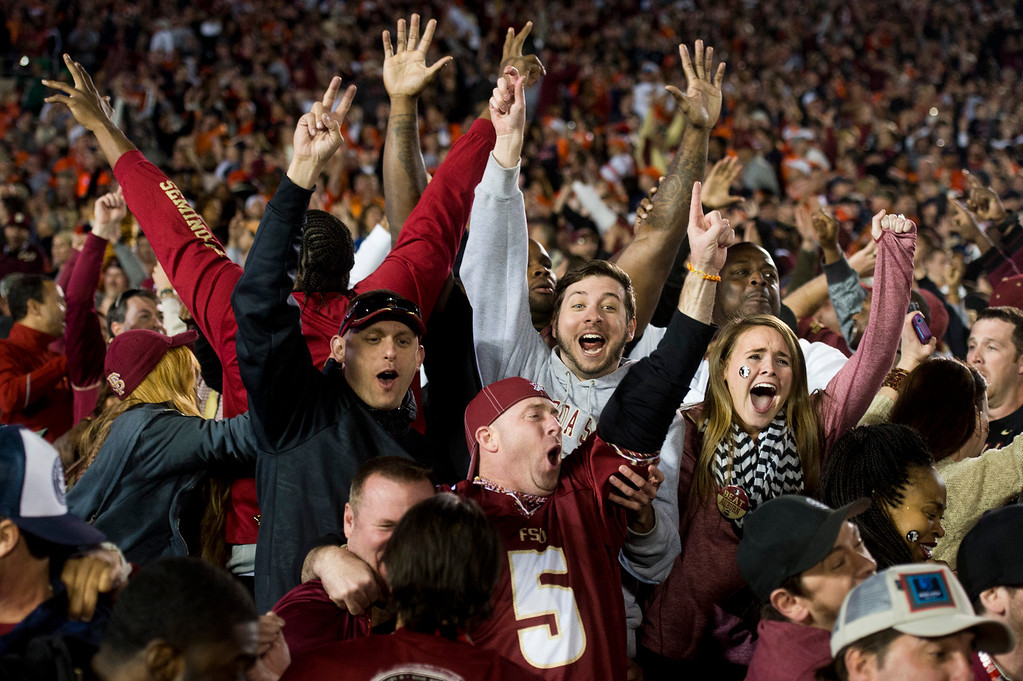 . Florida State fans celebrate their victory over Auburn in the BCS National Championship game at the Rose Bowl in Pasadena Calif. on Monday, Jan. 6, 2014. (Watchara Phomicinda/ Pasadena Star-News)