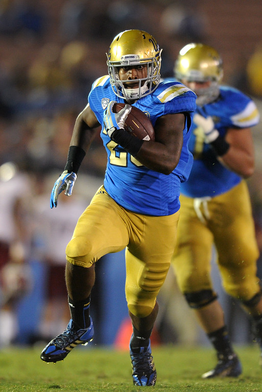 . UCLA RB Malcolm Jones goes for yardage against New Mexico State in the fourth quarter, Saturday, September 21, 2013, at the Rose Bowl. (Photo by Michael Owen Baker/L.A. Daily News)