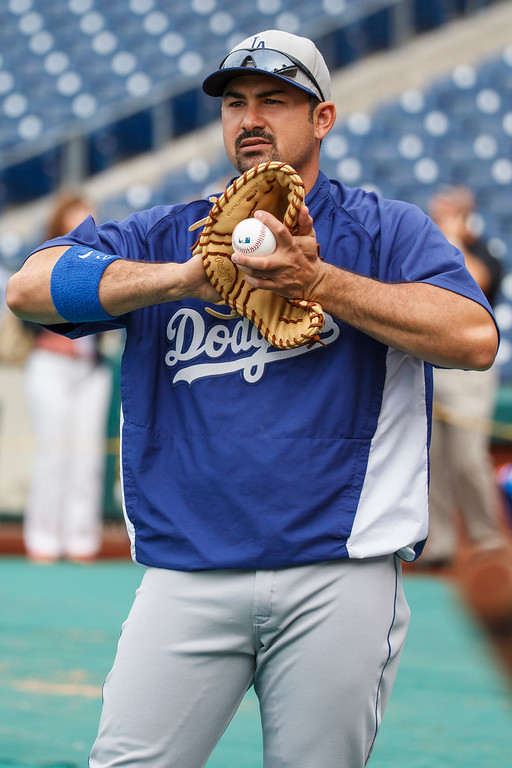 . Los Angeles Dodgers\' Adrian Gonzalez warms up prior to the Dodgers\' baseball game against the Philadelphia Phillies, Friday, Aug. 16, 2013, in Philadelphia. (AP Photo/Christopher Szagola)