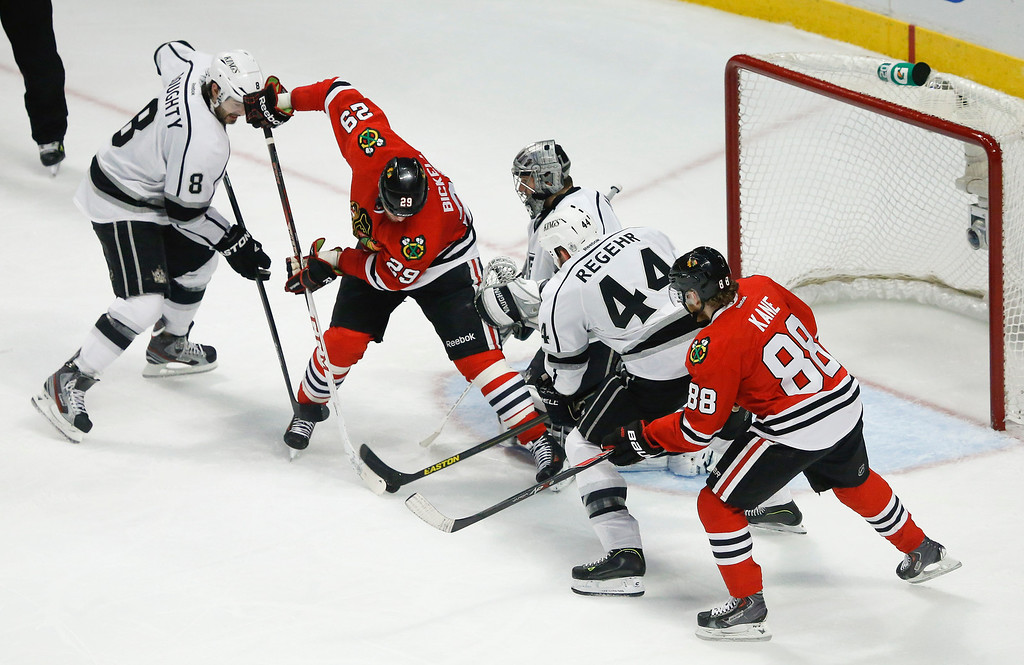 . Chicago Blackhawks left wing Bryan Bickell (29) shoots the puck to score against Los Angeles Kings defenseman Robyn Regehr (44), goalie Jonathan Quick (32) and Los Angeles Kings defenseman Drew Doughty (8) as Chicago Blackhawks right wing Patrick Kane (88) looks on during the second period in Game 2 of an NHL hockey Stanley Cup Western Conference finals Sunday, June 2, 2013 in Chicago. (AP Photo/Charles Rex Arbogast)