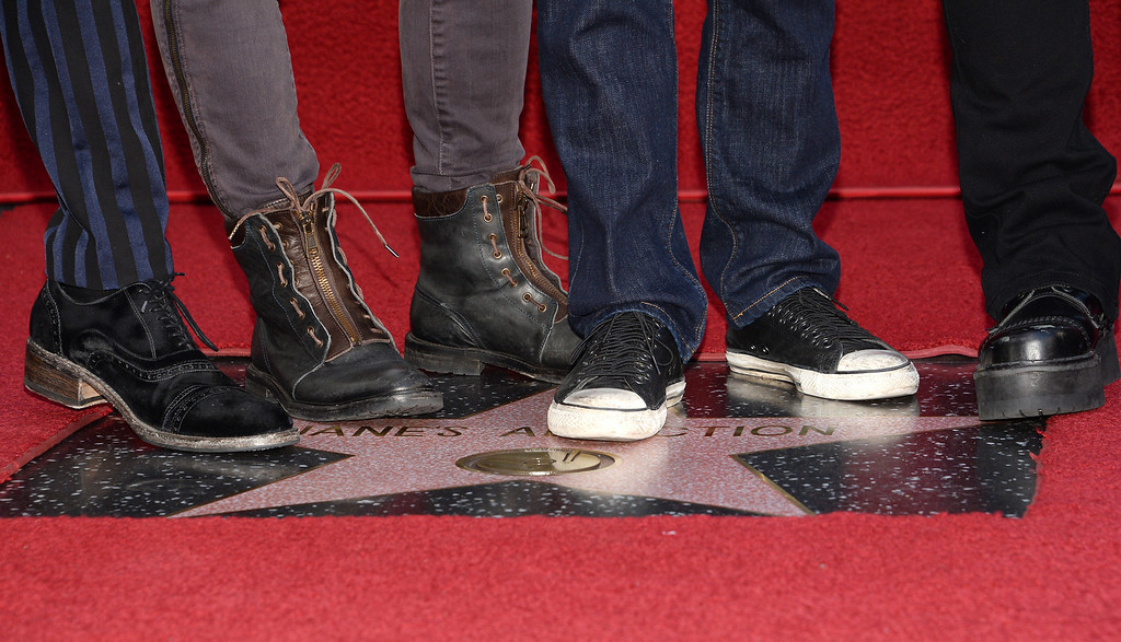 . From left: Perry Farrell, Stephen Perkins, Chris Chaney and Dave Navarro of the alt-rock band Jane\'s Addiction stand on their star at the ceremony honoring the band with a star on The Hollywood Walk of Fame, October 30, 2013 in Hollywood, California.           (ROBYN BECK/AFP/Getty Images)