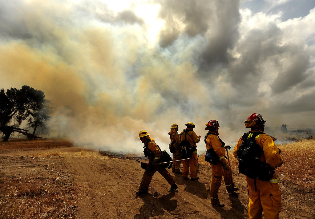 . A scene from a training fire along Sierra Avenue north of Summit Avenue in North Fontana May 23, 2013.  GABRIEL LUIS ACOSTA/STAFF PHOTOGRAPHER.