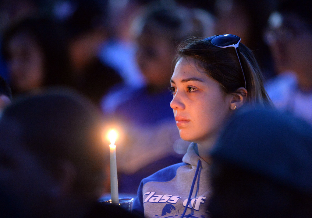 . A student holds a candle as family, students and members of the community gather in memory of Adrian Castro, 19, at El Monte High School Monday evening April 14, 2014. Castro was one of nine students killed in the bus crash in Orland, Calif. (Staff Photo by Keith Durflinger/San Gabriel Valley Tribune)