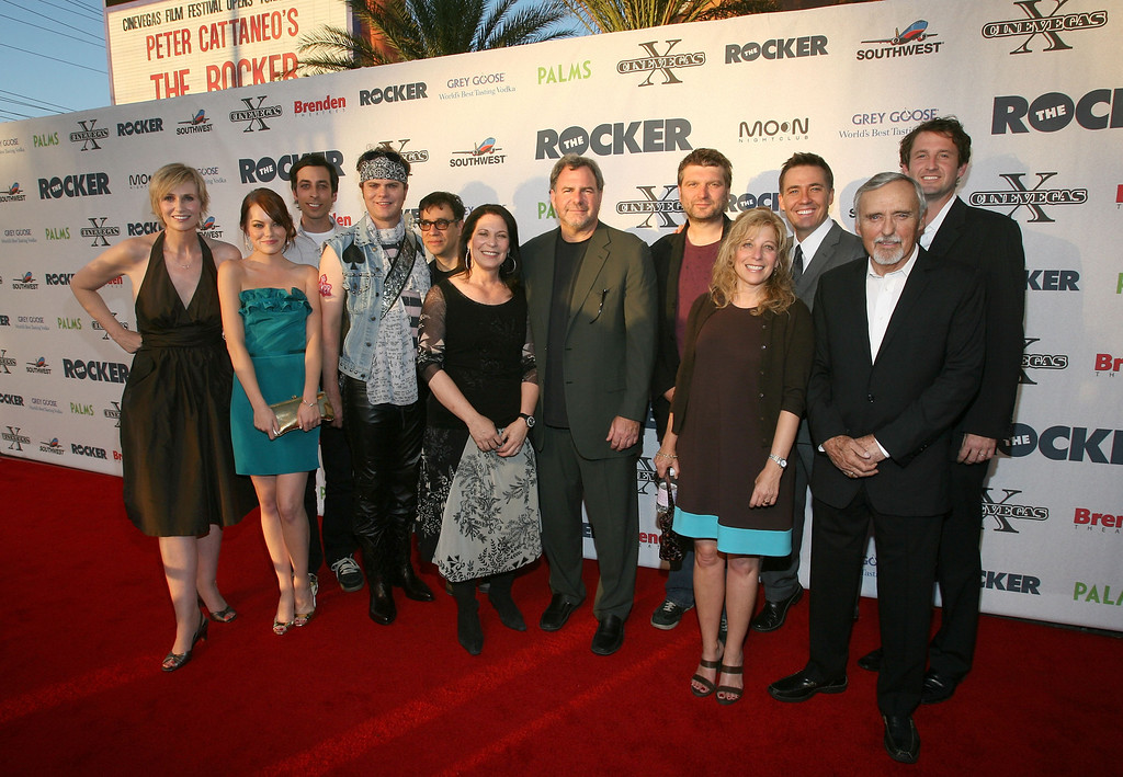 ". LAS VEGAS - JUNE 12:  (L-R) Actors Jane Lynch, Emma Stone, Lonny Ross, Rainn Wilson, Fred Armisen, CineVegas president Robin Greenspun, Danny Greenspun, director Peter Cattaneo, president of Fox Atomic Debbie Liebling, producer Tom McNulty, chair of the CineVegas creative advisory board Dennis Hopper, and CineVegas artistic director Trevor Groth arrive at the opening night screening of ""The Rocker\"" during the 2008 CineVegas film festival held at the Palms Casino Resort on June 12, 2008 in Las Vegas, Nevada.  (Photo by Ethan Miller/Getty Images for CineVegas)"