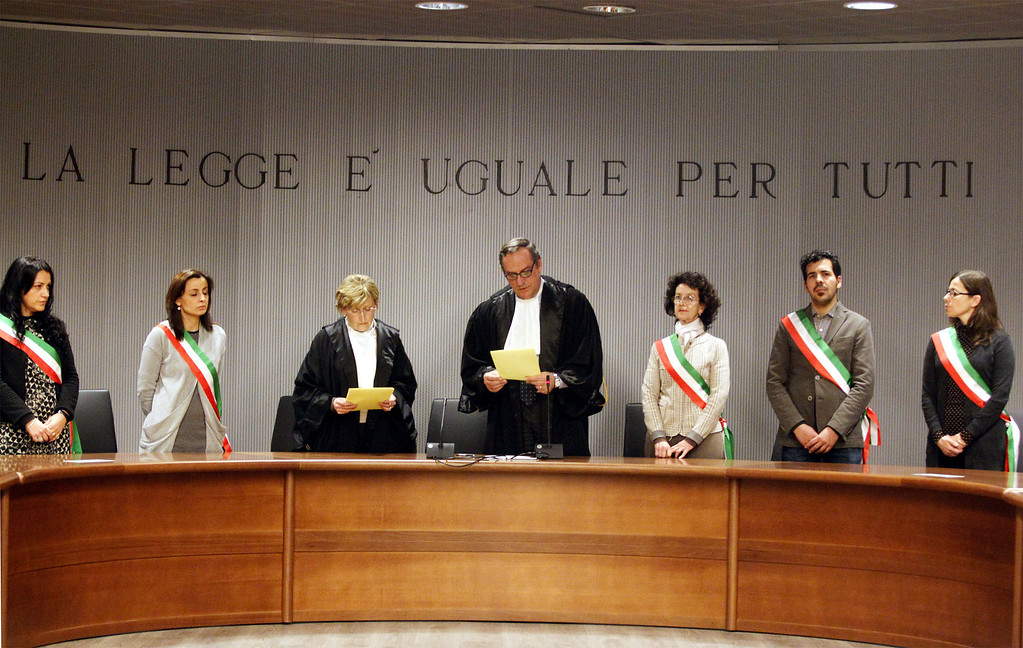 ". Appeals Court Judge Alessandro Nencini, center,  reads out the verdict for the murder of British student Meredith Kercher, in Florence, Italy, Thursday, Jan. 30, 2014. An appeals court in Florence upheld the convictions of  U.S. student Amanda Knox and her ex-boyfriend for the 2007 murder of her British roommate. Knox was sentenced to 28 1/2 years in prison, raising the specter of a long legal battle over her extradition. After nearly 12 hours of deliberation Thursday the court reinstated the guilty verdict first handed down against Knox and Raffaele Sollecito in 2009.  Writing above reads in Italian ""The Law is Equal for All.\""  (AP Photo/Fabrizio Giovannozzi)"