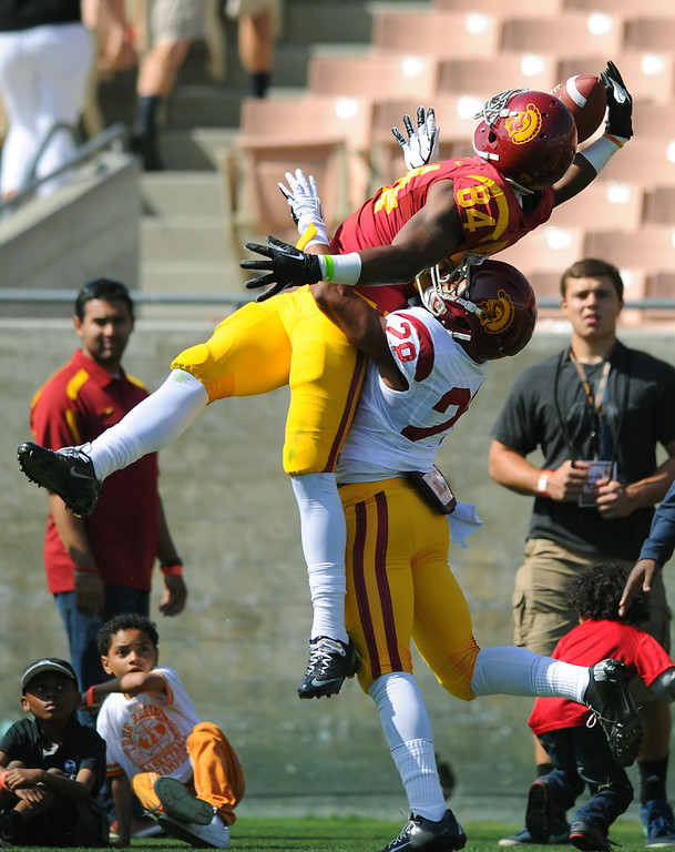 . USC WR Darreus Rogers hauls in a one-handed catch over DB Ryan Dillard during their spring game, Saturday, April 19, 2014, at the Coliseum. (Photo by Michael Owen Baker/L.A. Daily News)