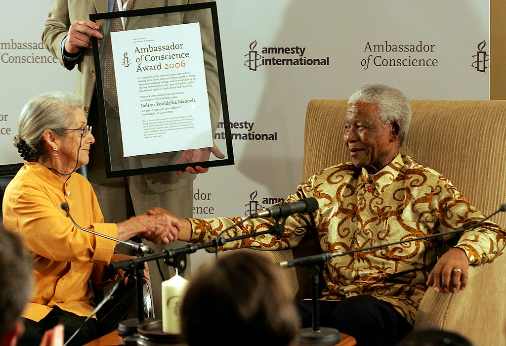 ". Former South African President Nelson Mandela, right, receives the Ambassador of Conscience Award from Nobel Prize winning-author Nadine Gordimer, left, at the Nelson Mandela Foundation in Johannesburg, South Africa, Wednesday, Nov. 1, 2006. Gordimer described Mandela as one of the greatest men of the 20 century and a man who through his leadership and dedication to justice and equality had put morality back into government. ""Like Amnesty International, I have struggled for justice and human rights for long years,\"" said Mandela when he accepted the award. (AP Photo/Themba Hadebe)"