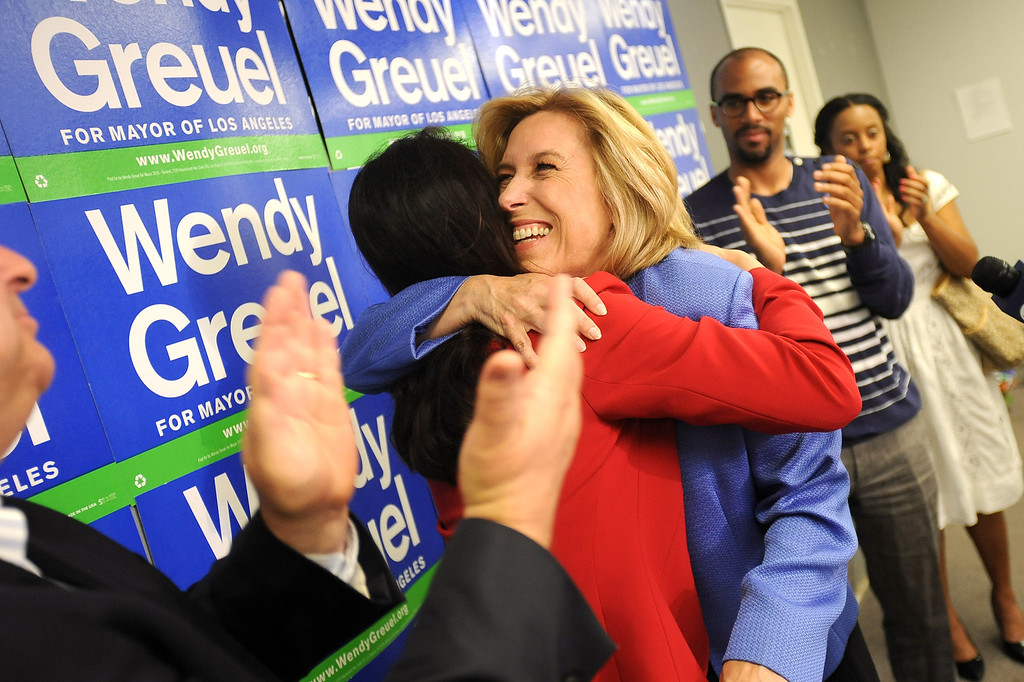 . Former mayoral candidate Wendy Greuel receives a hug from Hyepin Im following a press conference at her Van Nuys field office May 22, 2013.  Greuel was defeated by Eric Garcetti in a mayoral runoff Tuesday in Los Angeles.(Andy Holzman/Staff Photographer)