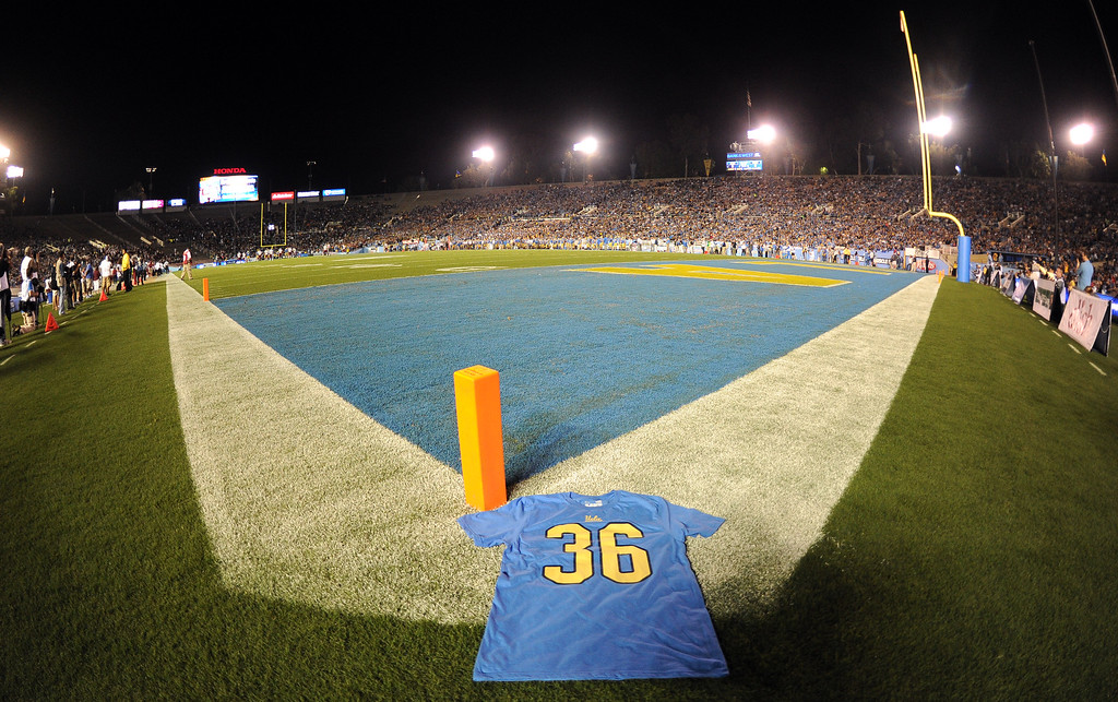 . A shirts with number (36) in the corner of the southwest end zone in honor of Nick Pasquale, the UCLA receiver who was struck and killed by a car earlier during a college football game against New Mexico State in the Rose Bowl in Pasadena, Calif., on Saturday, Sept. 21, 2013.   (Keith Birmingham Pasadena Star-News)