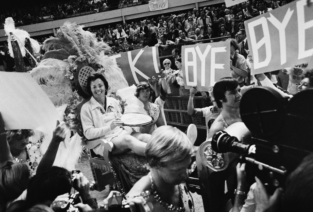 . Ms. Billie Jean King waves to crowds at the Astrodome in Houston, Tex., Sep 20,1973 as she is borne onto the crowd on a multi-colored throne carried by four men for her match with Bobby Riggs.(AP Photo)