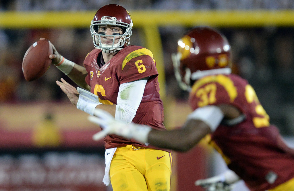 . USC�s Cody Kessler #6 passes the ball to Javorius Allen #37 during their game at the Los Angeles Memorial Coliseum Saturday, November 30, 2013.  UCLA beat USC 35-14. (Photo by Hans Gutknecht/Los Angeles Daily News)