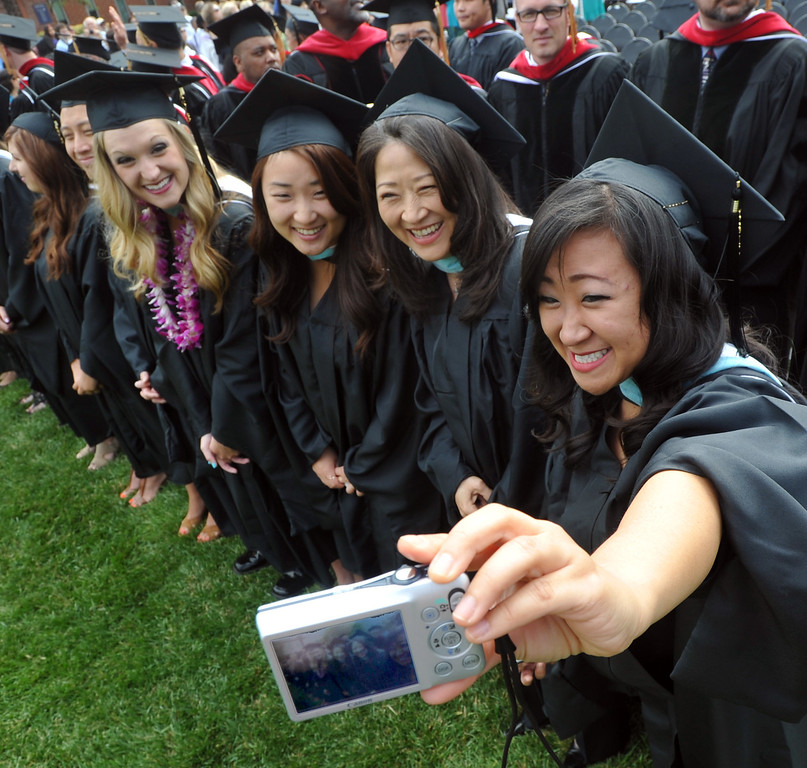 . Uriah Lee, right takes a picture of, from left, Katie Klingbeil, Jessica Lee, and Kathryn Lee during the Graduate and Bold Program Commencement ceremony at Biola University in La Mirada on Friday May 24, 2013. An estimated 340 graduate and Bold program students receive their diplomas during the morning ceremony. (SGVN/Staff Photo by Keith Durflinger)