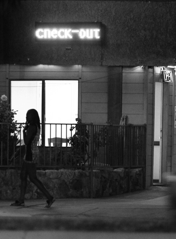 . A woman walks past a motel on Sepulveda Blvd. in an area identified by police as a corridor for prostitution activity. North Hills, CA. 4/30/2014(Photo by John McCoy / Los Angeles Daily News)