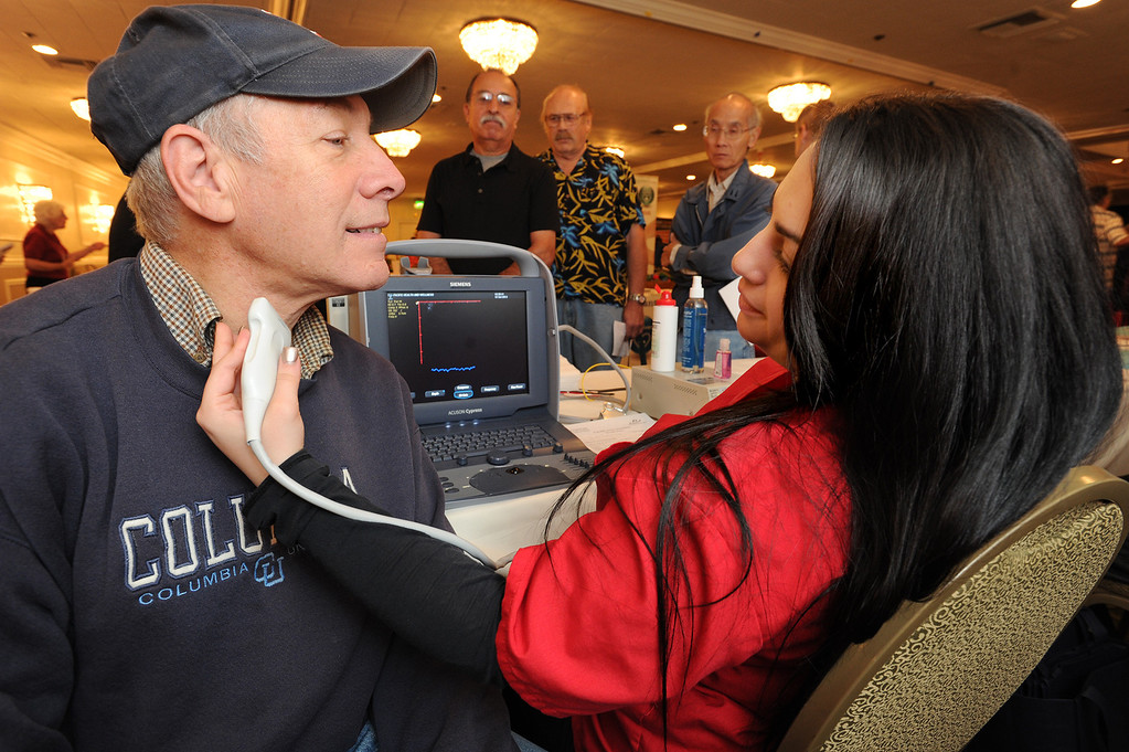 . Bob Levine has an ultra sound examination of his Carotid Artery by Ani Ter-Arutyunyan who works for Health Care Partners Medical Group. The 4th annual Successful Aging Expo was held Saturday at the Sportsmen�s Lodge Events Center in Studio City, CA. 10/12/2013. photo by (John McCoy/Los Angeles Daily News)