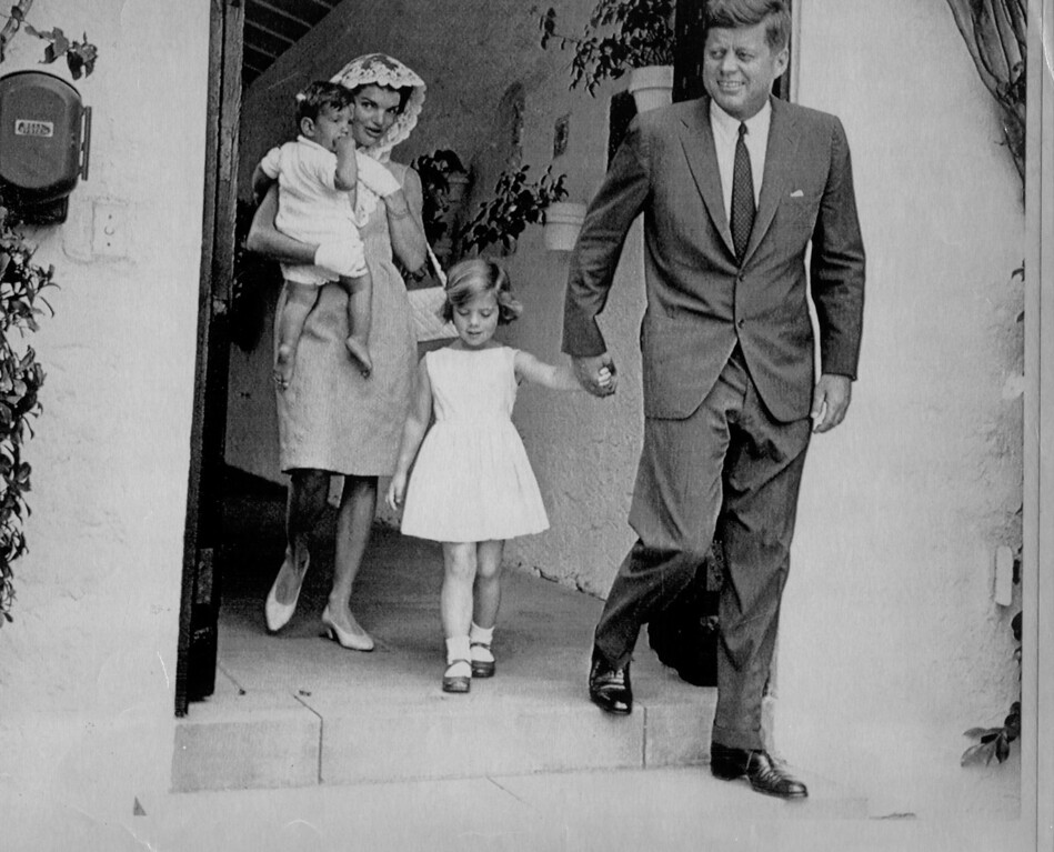 . President John F. Kennedy holds the hand of his daughter Caroline as his wife Jacqueline carries their son John Jr. (April 1962)   Los Angeles Daily News file photo