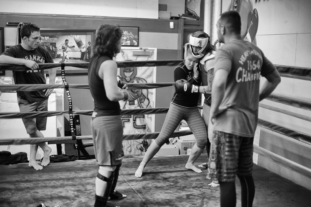 . Jake Ellenberger, Shayna Baszler and coach Edmond Tarverdyan watch as Ronda Rousey demonstrates a technique with the help of Jessamyn Duke at the Glendale Fighting Club in Glendale. (Photo by Hans Gutknecht/Los Angeles Daily News)