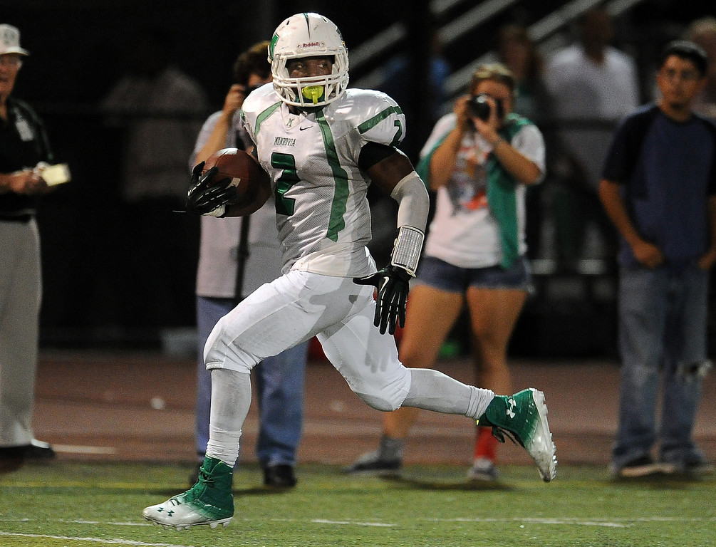. Monrovia\'s Kurt Scoby (2) runs for 50 yard touchdown against Arcadia in the first half of a prep football game at Arcadia High School in Arcadia, Calif. on Friday, Sept. 13, 2013.   (Photo by Keith Birmingham/Pasadena Star-News)