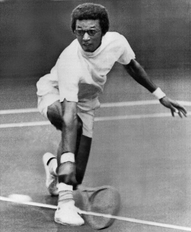 . Arthur Ashe of Richmond, Va., makes a backhand return to Georges Goven of France during semifinals match in the Paris Open indoor tennis tournament in the French capital on Saturday, Nov. 14, 1970. He defeated Goven, 7-6, 7-6, 6-3, and will face Martin Riessen, also an American, in the finals. (AP Photo)