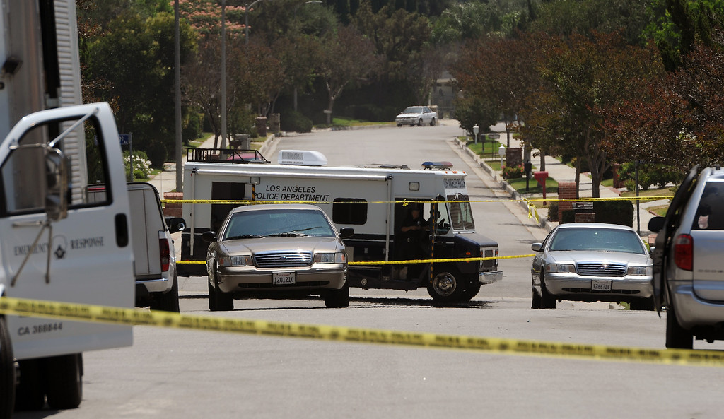 . The scene on the 19200 block of Kenya Street in Northridge, Friday, June 15, 2013, where a woman was murdered and the suspect surrendered to SWAT officers following a nighttime standoff. (Michael Owen Baker/Staff Photographer)