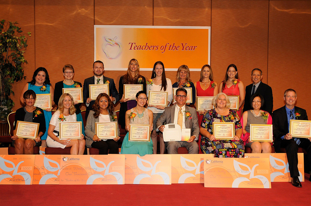 . Sixteen teachers from throughout the Los Angeles County were named as Teachers of the Year during a ceremony at the Universal Hilton. Teachers received a cash award from the California Credit Union as well as software and hardware to use in their classrooms from eInstruction. Universal City, CA. 9/27/2013. photo by (John McCoy/Los Angeles Daily News)
