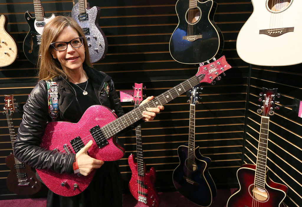. ANAHEIM, CA - JANUARY 24:  Singer Lisa Loeb  attends the 2014 National Association of Music Merchants show at the Anaheim Convention Center on January 24, 2014 in Anaheim, California.  (Photo by Jesse Grant/Getty Images for NAMM)