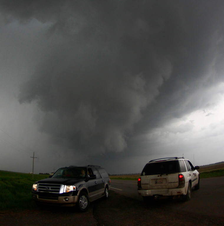 . A storm chaser get close to a tornadic thunderstorm one of several tornadoes that touched down Sunday May 19th in Kansas.  The tornadoes that touched down in Oklahoma and Kansas and Iowa were part of a massive, northeastward-moving storm system that stretched from Texas to Minnesota. At least four separate tornadoes touched down in central Oklahoma late Sunday afternoon, including the one near the town of Shawnee were one person was killed 35 miles southeast of Oklahoma City. May 19.2013. South Haven Kansas. Photo by Gene Blevins/LA Daily News
