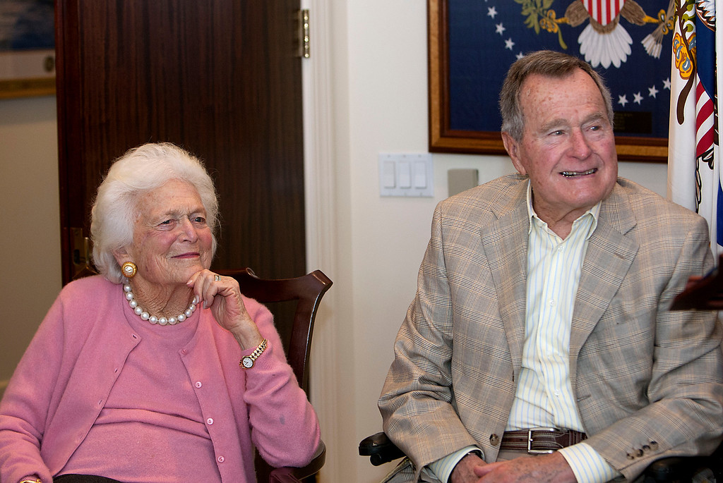. In this Dec. 23, 2013 photo, former first Lady Barbara Bush left, and former President George H. W. Bush look on during a ceremony  at President Bush\'s office in Houston.  Former first lady Barbara Bush has been hospitalized in Houston with a respiratory-related issue, Tuesday, Dec. 31, 2013. A statement Tuesday night from the office of her husband, former President George H.W. Bush, said she was admitted to Houston Methodist Hospital on Monday. (AP Photo/Houston Chronicle, James Nielsen)