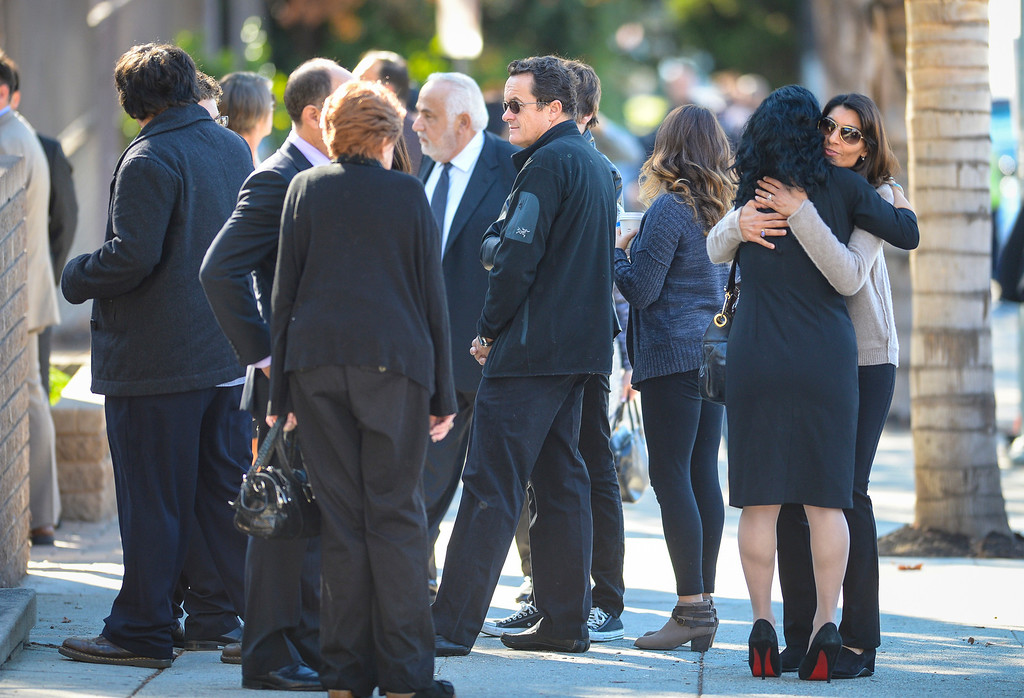. Family and friends arrive at funeral services for Joseph Gatto  at Our Mother of Good Counsel Catholic church on Monday November 25, 2013.  Joseph Gatto was found dead in his Silver Lake home on November 13th.    ( Photo by David Crane/Los Angeles Daily News )