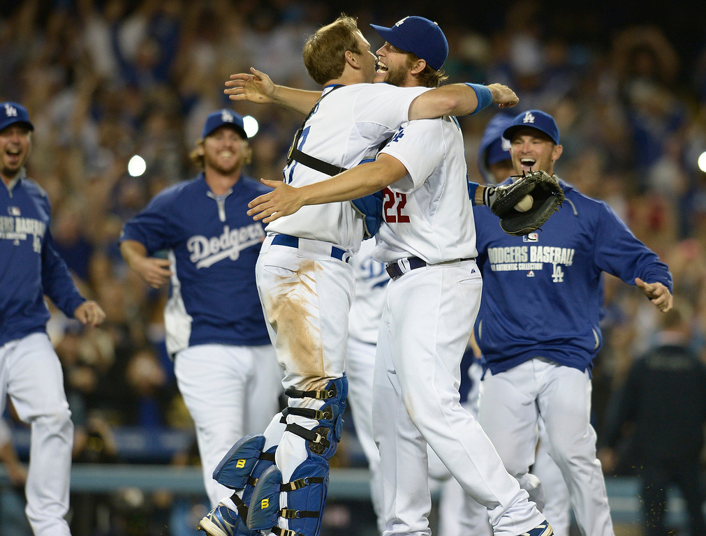 . Clayton Kershaw gets a hug from catcher A.J. Ellis after he throws a no hitter. The Dodgers defeated the Colorado Rockies 8-0 at Dodger Stadium in Los Angeles, CA. 6/18/2014(Photo by John McCoy Daily News)