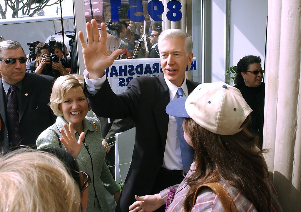 . 10/07/03--WEST HOLLYWOOD--Califonia Gov. Gray Davis and wife Sharon wave to supporters as they enter their West Hollywood polling place to cast heir votes during the California recall election Tuesday, October 7th, 2003. (Gus Ruelas/LA Daily News)