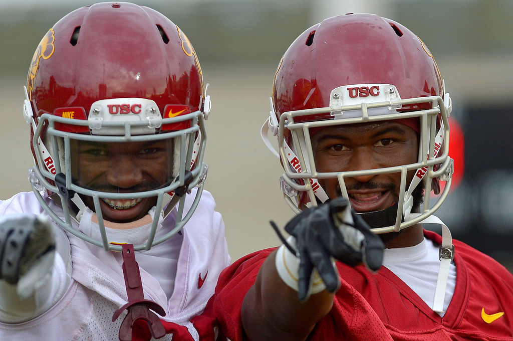 . Sophmore running back Buck Allen and Leon McQuay during USC\'s final practice of the 2013 season December 18, 2013 in Los Angeles, CA.  The team flies to Las Vegas to play Fresno State in the Las Vegas Bowl on December 21, 2013.(Andy Holzman/Los Angeles Daily News)