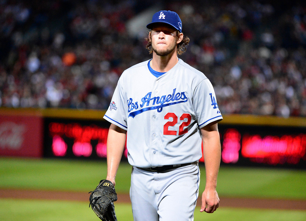 . Los Angeles Dodgers\' Clayton Kershaw comes off the field after striking out three straight players in the fifth and after getting out  with bases loaded as they play the Atlanta Braves in the first game of the playoffs Thursday, October 3, 2013 at Turner Field in Atlanta, Georgia. (Photo by Sarah Reingewirtz/Pasadena Star- News)