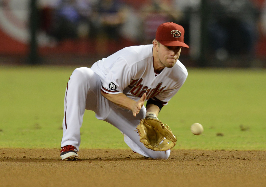 . PHOENIX, AZ - SEPTEMBER 16:  Aaron Hill #2 of the Arizona Diamondbacks makes a play on a ground ball against the Los Angeles Dodgers at Chase Field on September 16, 2013 in Phoenix, Arizona.  (Photo by Norm Hall/Getty Images)