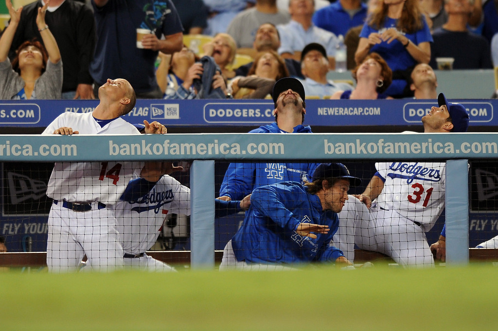 . Dodgers in the dugout scramble out of the way of a popup during their game against the Giants, Thursday, September 12, 2013, at Dodger Stadium. (Photo by Michael Owen Baker/L.A. Daily News)