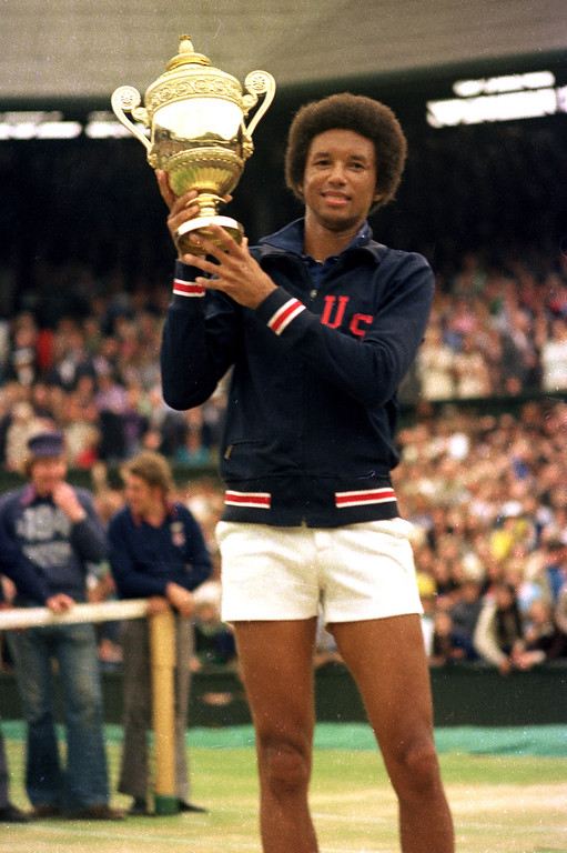 . Arthur Ashe holds his Wimbledon trophy cup after defeating fellow American Jimmy Connors in the final match of the men\'s singles championship at the All England Lawn Tennis Championship in Wimbledon, England, July 5, 1975.  (AP Photo)