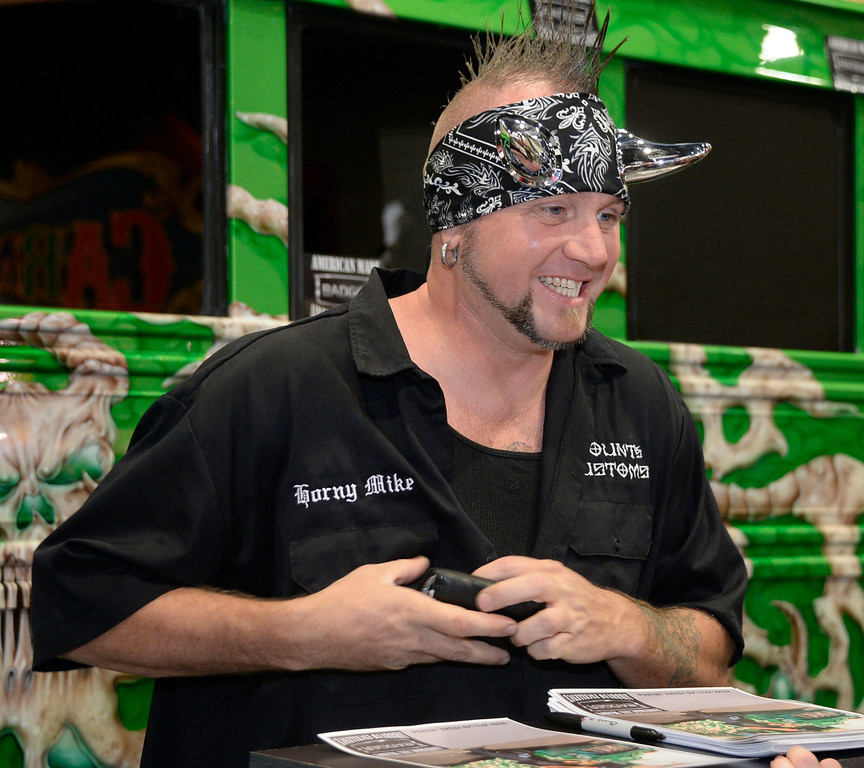 . Nov 6,2013 Las Vegas NV. USA. Airbrush artist  Horny Mike from the cable show Counting Cars, signs autographs during the second day of the 2013 SEMA auto show.