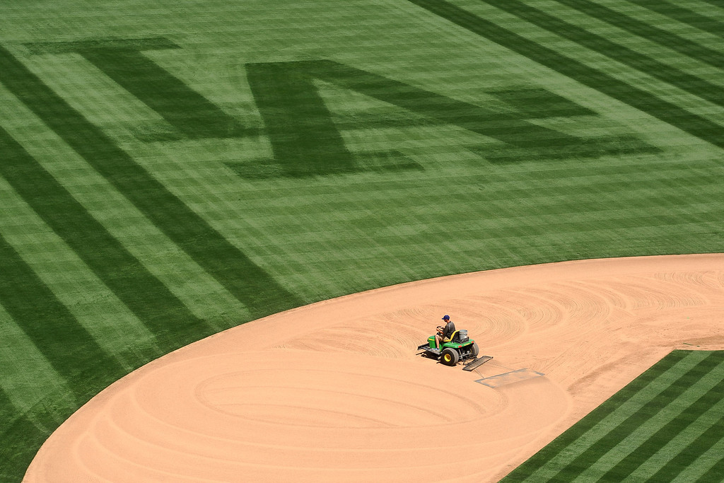 . Dodger Stadium grounds crew assistant Jordan Lorenz prepares the field for the Opening Weekend series with the Giants Thursday April 3, 2014.(Andy Holzman/Los Angeles Daily News)