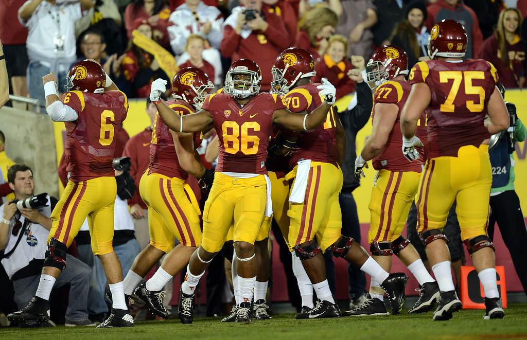 . USC players react after a first half touchdown during their game against Stanford  at the Los Angeles Memorial Coliseum Saturday, November 16, 2013. (Photos by Hans Gutknecht/Los Angeles Daily News)